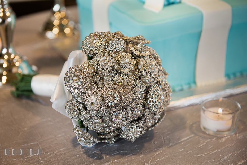 A bouquet of silver brooches from Rentals to Remember. Historic Events Annapolis bridal shower decor and event coverage at Annapolis Maryland, by wedding photographers of Leo Dj Photography. http://leodjphoto.com