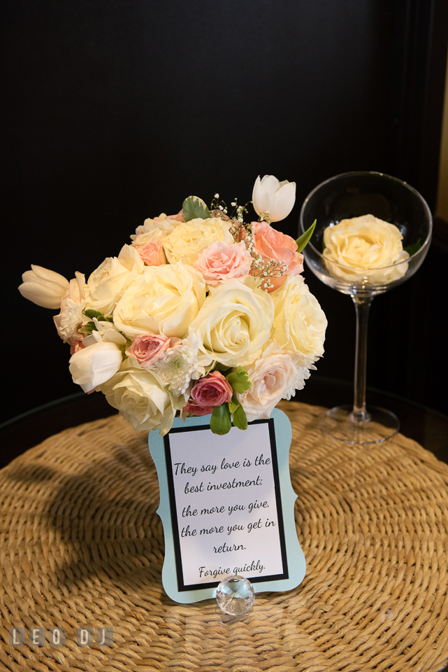 A bouquet of white and pink roses with a card of life advice. Historic Events Annapolis bridal shower decor and event coverage at Annapolis Maryland, by wedding photographers of Leo Dj Photography. http://leodjphoto.com