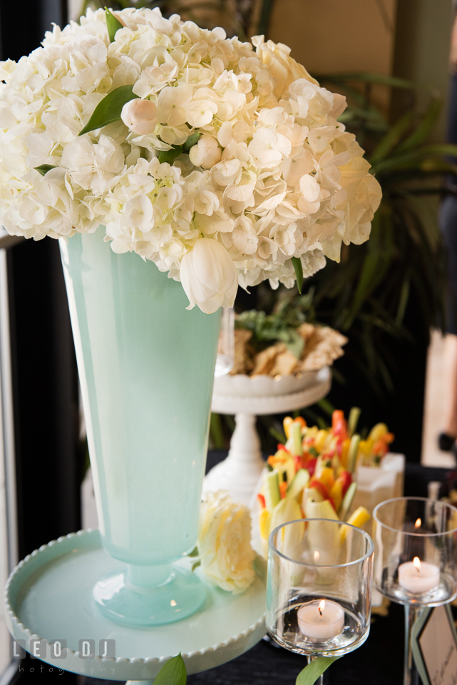 An arrangement of hydrangeas in a tall vase. Historic Events Annapolis bridal shower decor and event coverage at Annapolis Maryland, by wedding photographers of Leo Dj Photography. http://leodjphoto.com