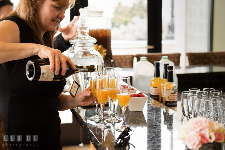 Mother of Bride-to-be pouring drinks on champagne glasses. Historic Events Annapolis bridal shower decor and event coverage at Annapolis Maryland, by wedding photographers of Leo Dj Photography. http://leodjphoto.com