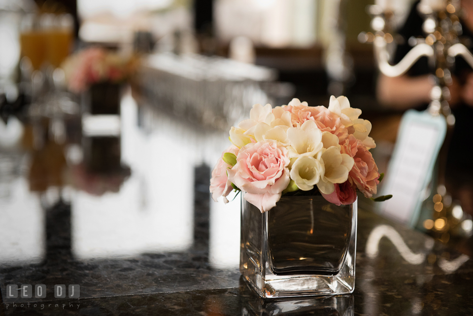 Arrangement of pink rose and white crocus on the bar table. Historic Events Annapolis bridal shower decor and event coverage at Annapolis Maryland, by wedding photographers of Leo Dj Photography. http://leodjphoto.com