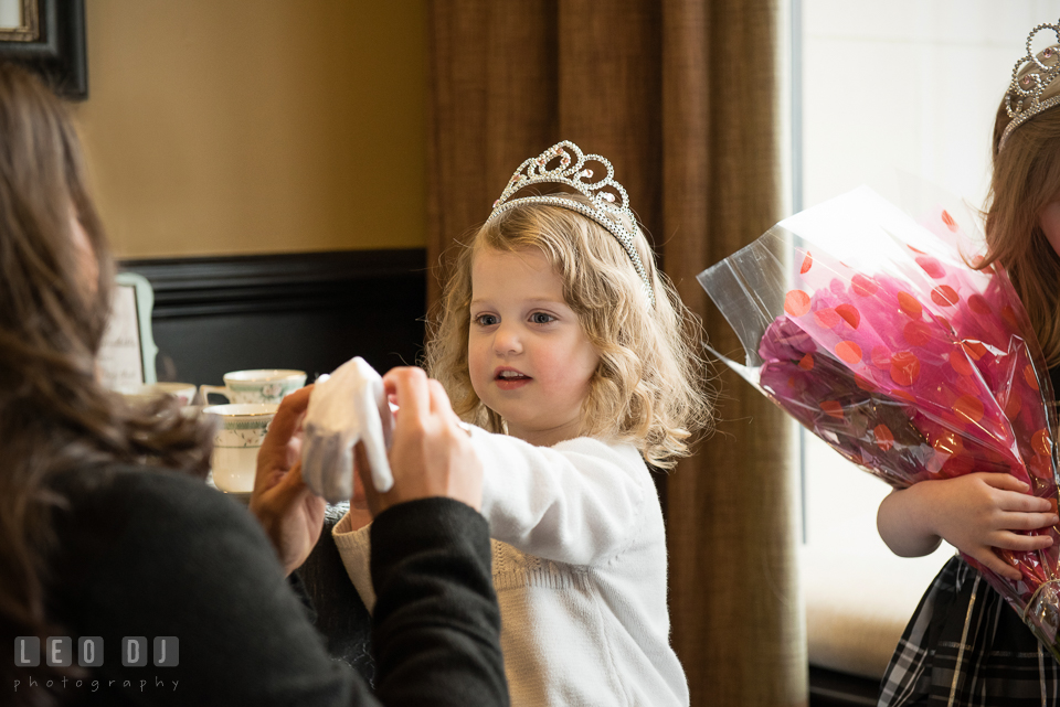 Guest helping putting on white gloves for a little girl with tiara. Historic Events Annapolis bridal shower decor and event coverage at Annapolis Maryland, by wedding photographers of Leo Dj Photography. http://leodjphoto.com