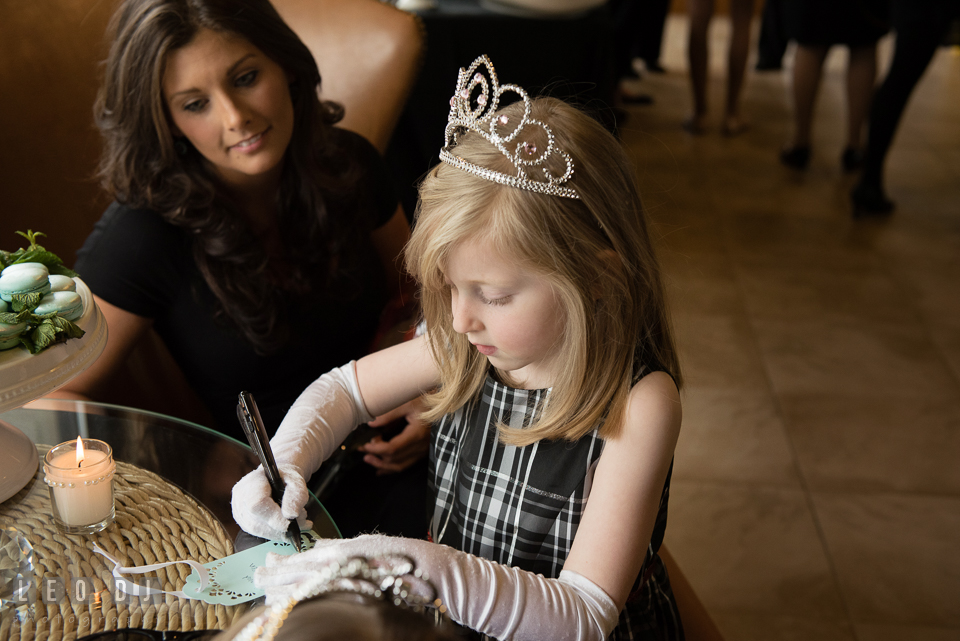 Little girl wearing tiara writing well wishes for the Bride-to-be. Historic Events Annapolis bridal shower decor and event coverage at Annapolis Maryland, by wedding photographers of Leo Dj Photography. http://leodjphoto.com