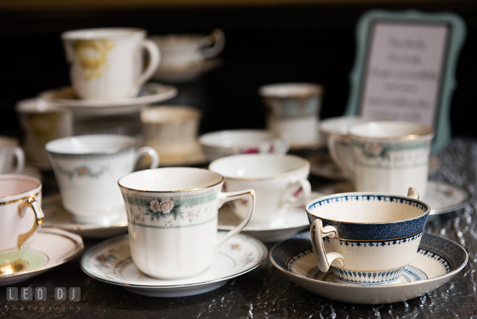 Selections of traditional English tea are served with vintage tea sets to accompany the party. Historic Events Annapolis bridal shower decor and event coverage at Annapolis Maryland, by wedding photographers of Leo Dj Photography. http://leodjphoto.com