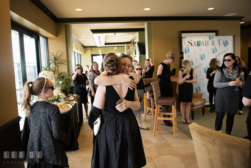 Mother of the Bride-to-be hugging her daugther. Historic Events Annapolis bridal shower decor and event coverage at Annapolis Maryland, by wedding photographers of Leo Dj Photography. http://leodjphoto.com