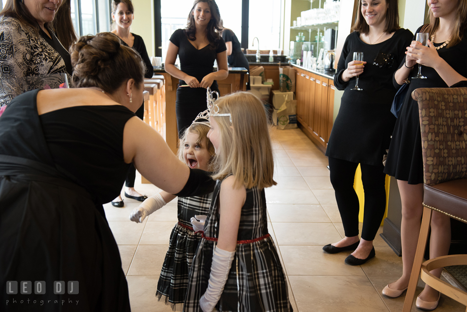 Bride-to-be about to hug the little princesses. Historic Events Annapolis bridal shower decor and event coverage at Annapolis Maryland, by wedding photographers of Leo Dj Photography. http://leodjphoto.com