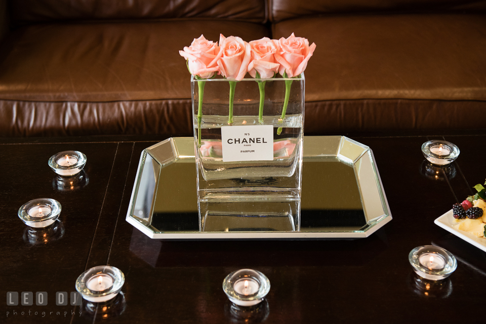 Four pink roses in Chanel No. 5 parfum vase. Historic Events Annapolis bridal shower decor and event coverage at Annapolis Maryland, by wedding photographers of Leo Dj Photography. http://leodjphoto.com