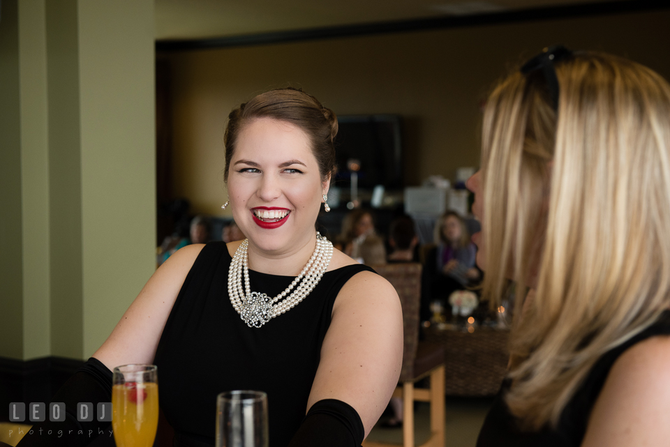Bride to be smiling with guests. Historic Events Annapolis bridal shower decor and event coverage at Annapolis Maryland, by wedding photographers of Leo Dj Photography. http://leodjphoto.com