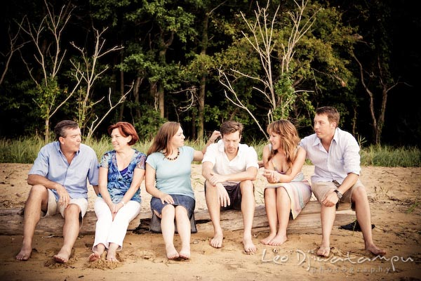 Family sitting on a log on the beach. Kent Island Annapolis Candid Family Portrait Photo Session Photography Eastern Shore Maryland MD DC