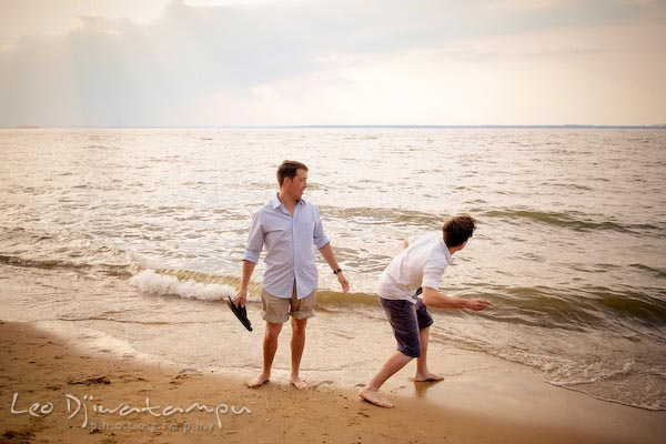 Guy throwing rock at wave. Kent Island Annapolis Candid Family Portrait Photo Session Photography Eastern Shore Maryland MD DC