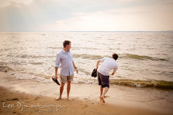 Throwing rock to water, brother looking. Kent Island Annapolis Candid Family Portrait Photo Session Photography Eastern Shore Maryland MD DC