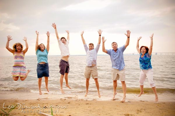 Family, mother, father, children jumping at Chesapeake Bay Beach. Kent Island Annapolis Candid Family Portrait Photo Session Photography Eastern Shore Maryland MD DC