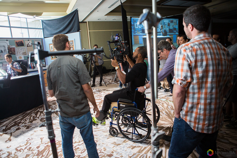 Shane pushing a camera operator using a wheel chair in place of a dolly on a track. Review of MZed Illumination Experience, film making and cinematography Workshop with Hollywood Cinematographer Shane Hurlbut by wedding photographer Leo Dj Photography. http://leodjphoto.com