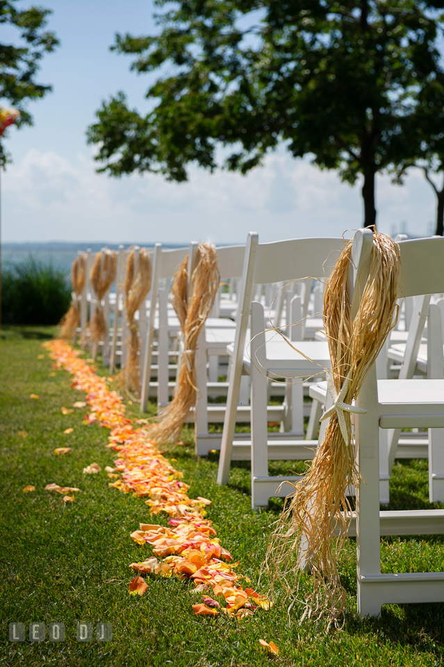 Decor of flower petals and hay straw with starfish along the ceremonial site aisle by florist Intrigue Design and Decor. Kent Island Maryland Chesapeake Bay Beach Club wedding photo, by wedding photographers of Leo Dj Photography. http://leodjphoto.com