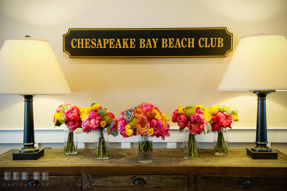 Bride and Bridesmaids flower bouquet on table by florist Intrigue Design and Decor. Kent Island Maryland Chesapeake Bay Beach Club wedding photo, by wedding photographers of Leo Dj Photography. http://leodjphoto.com