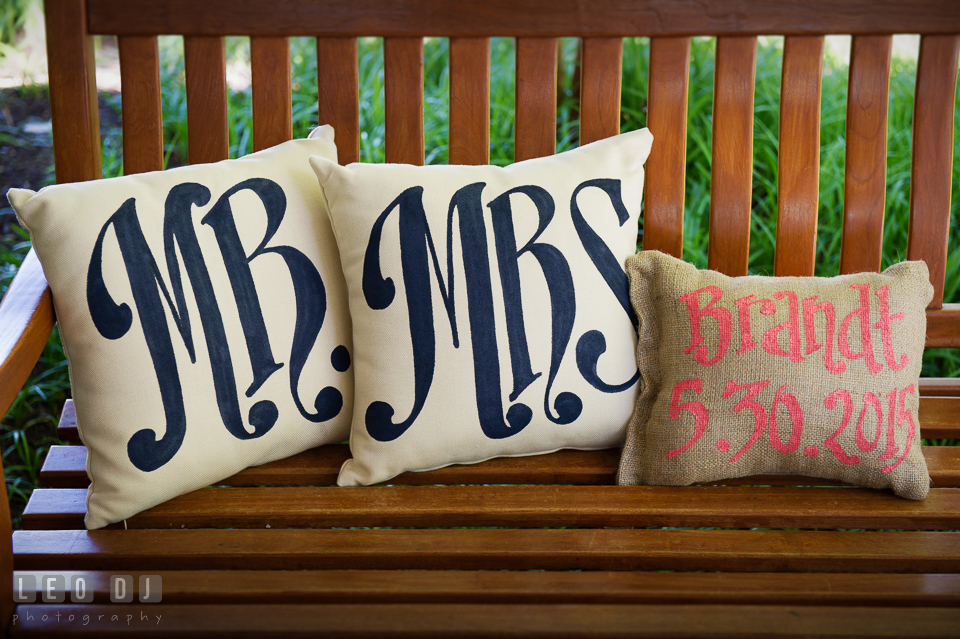 Pillows with Mr and Mrs lettering and one with last name and their wedding dates. Kent Island Maryland Chesapeake Bay Beach Club wedding photo, by wedding photographers of Leo Dj Photography. http://leodjphoto.com