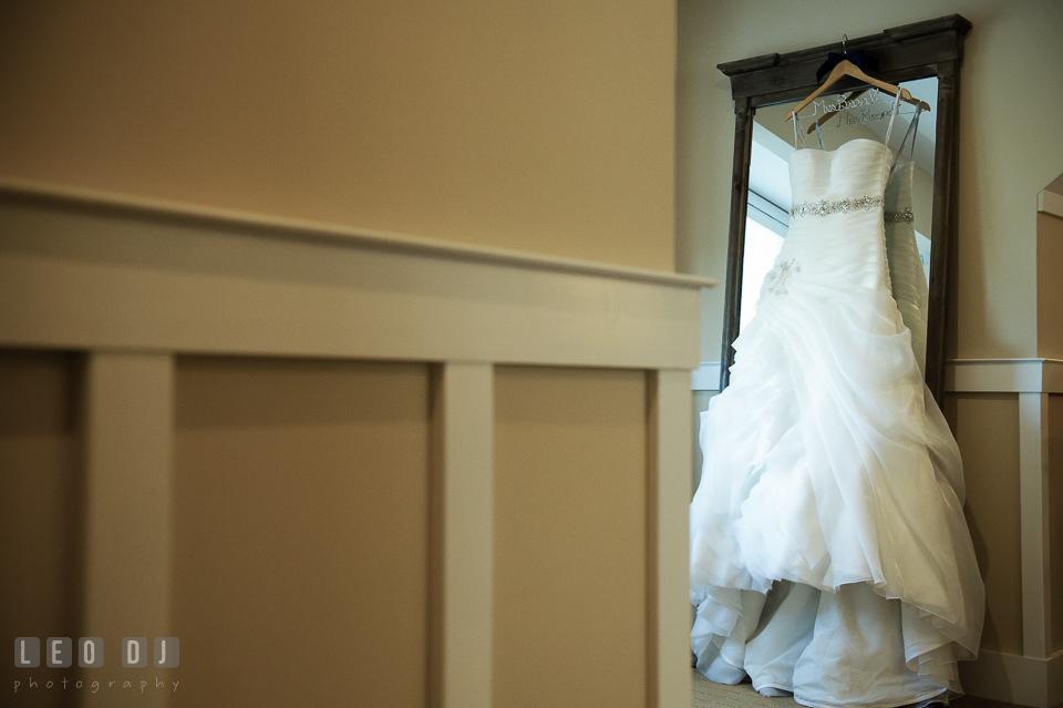 Bride's beautiful wedding gown from White Swan Bridal in Vienna, VA, designed by Kittychen Couture. Kent Island Maryland Chesapeake Bay Beach Club wedding photo, by wedding photographers of Leo Dj Photography. http://leodjphoto.com