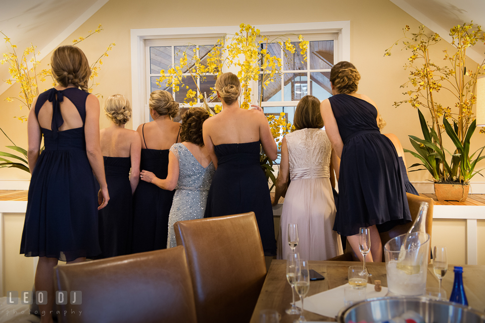 Mother of Bride, Mother of Groom, Bridesmaids and Matron of Honor looking at guests coming. Kent Island Maryland Chesapeake Bay Beach Club wedding photo, by wedding photographers of Leo Dj Photography. http://leodjphoto.com