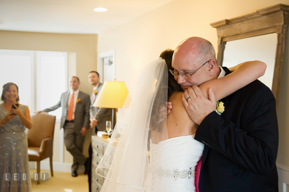 Father of the Bride and and daughter hugging during their first look. Kent Island Maryland Chesapeake Bay Beach Club wedding photo, by wedding photographers of Leo Dj Photography. http://leodjphoto.com