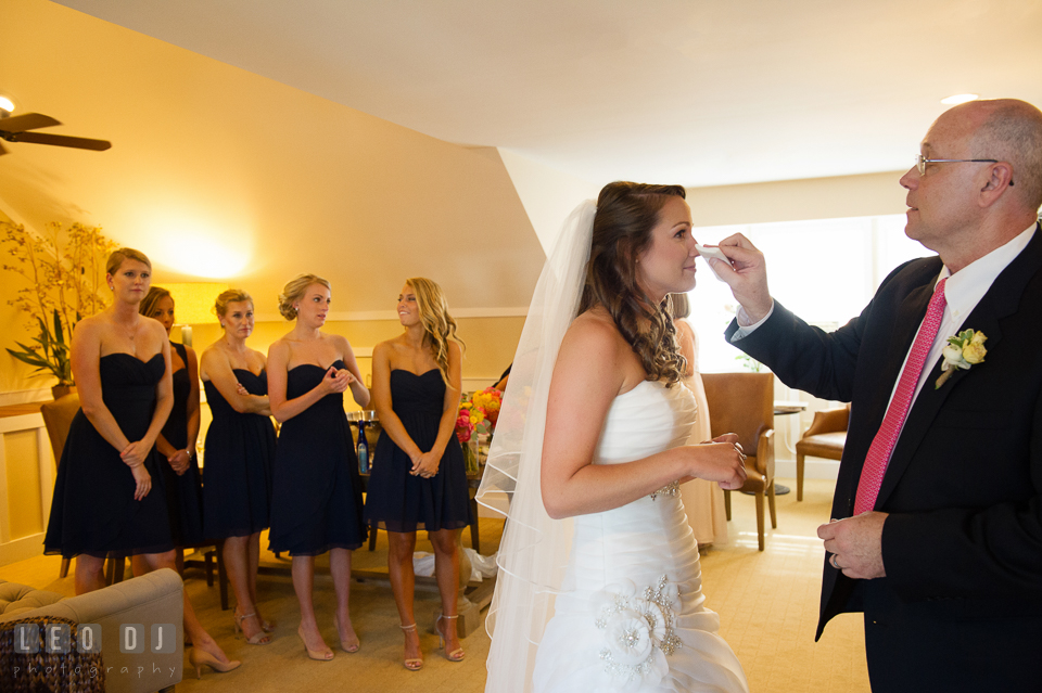 Father of the Bride wiping of tears from his daughter's eyes during the first look. Kent Island Maryland Chesapeake Bay Beach Club wedding photo, by wedding photographers of Leo Dj Photography. http://leodjphoto.com