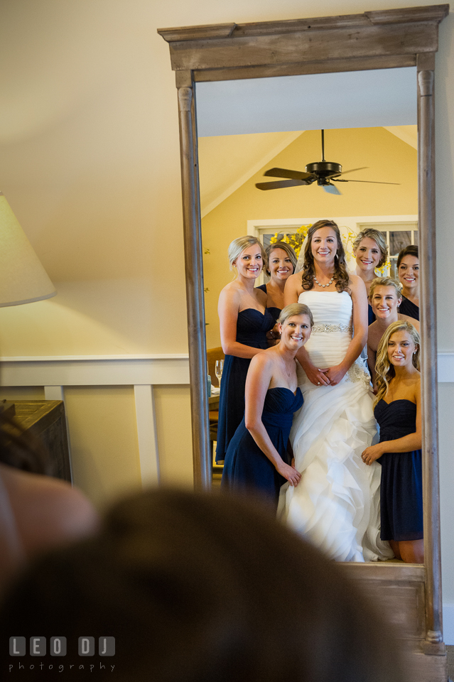 Bride with maid of honor and bridesmaids looking at the mirror. Kent Island Maryland Chesapeake Bay Beach Club wedding photo, by wedding photographers of Leo Dj Photography. http://leodjphoto.com