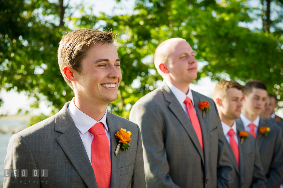 Groom smiling happy seeing Bride for the first time as she was walking down the aisle escorted by the Father of the Bride. Kent Island Maryland Chesapeake Bay Beach Club wedding photo, by wedding photographers of Leo Dj Photography. http://leodjphoto.com