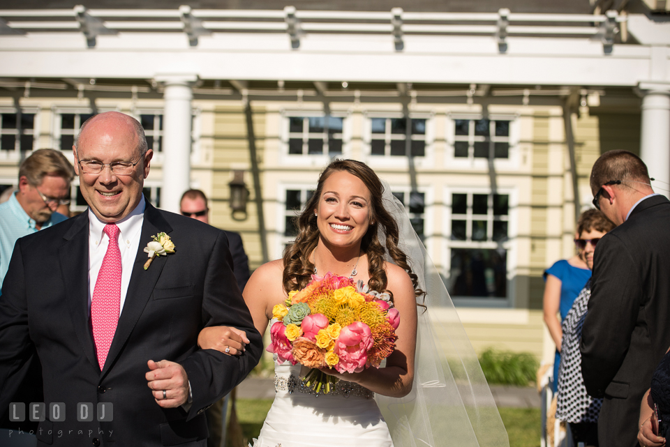 Bride smiling seeing Groom for the first time as she was walking down the aisle escorted by her Father. Kent Island Maryland Chesapeake Bay Beach Club wedding photo, by wedding photographers of Leo Dj Photography. http://leodjphoto.com
