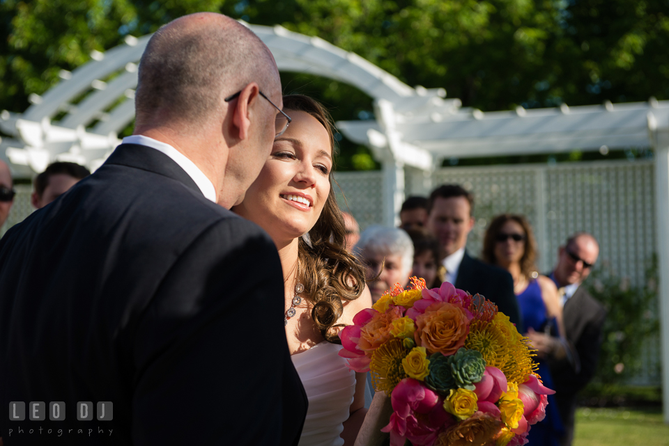 Father of the Bride giving away his daughter and kissed her. Kent Island Maryland Chesapeake Bay Beach Club wedding photo, by wedding photographers of Leo Dj Photography. http://leodjphoto.com
