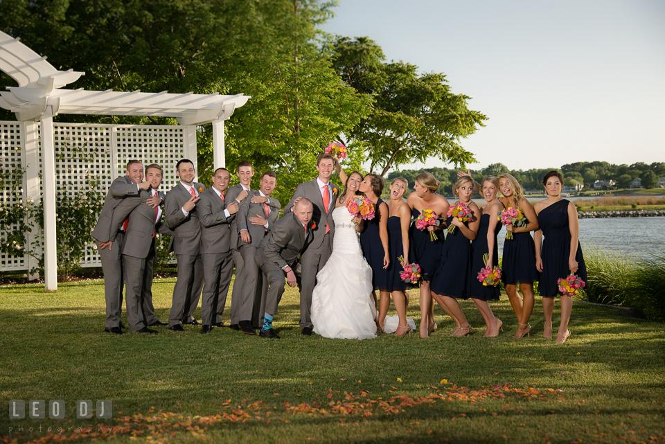 Bride, Groom and their bridal and groom party doing a goofy pose. Kent Island Maryland Chesapeake Bay Beach Club wedding photo, by wedding photographers of Leo Dj Photography. http://leodjphoto.com