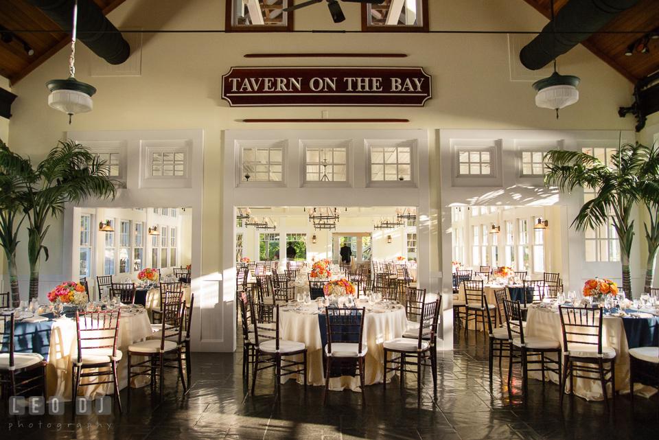 Arrangement of tables in the Tavern on the Bay dining hall. Kent Island Maryland Chesapeake Bay Beach Club wedding photo, by wedding photographers of Leo Dj Photography. http://leodjphoto.com