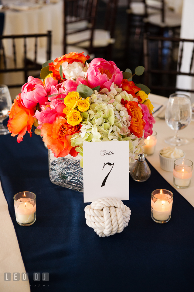 Monkey knot and vibrant colored flower centerpieces containing pink peonies, orange and yellow roses, and white hydrangea by florist Intrigue Design and Decor. Kent Island Maryland Chesapeake Bay Beach Club wedding photo, by wedding photographers of Leo Dj Photography. http://leodjphoto.com