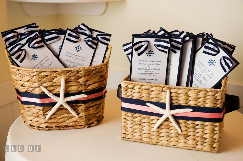 Ceremony program cards in basket decorated in basket decorated with nautical themed ribbon and starfish. Kent Island Maryland Chesapeake Bay Beach Club wedding photo, by wedding photographers of Leo Dj Photography. http://leodjphoto.com
