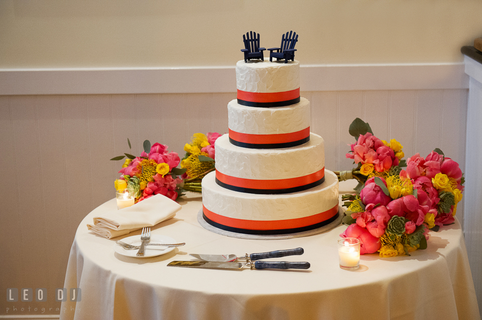 Beach and nautical themed wedding cake by Fiona's Cakes surrounded by bridesmaids flower bouquets by florist Intrigue Design and Decor. Kent Island Maryland Chesapeake Bay Beach Club wedding photo, by wedding photographers of Leo Dj Photography. http://leodjphoto.com