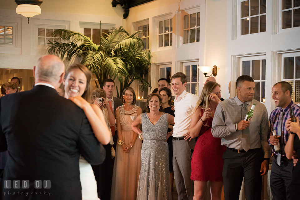 Father of the Bride dancing with daughter while Mother and Groom observing and laughing. Kent Island Maryland Chesapeake Bay Beach Club wedding photo, by wedding photographers of Leo Dj Photography. http://leodjphoto.com