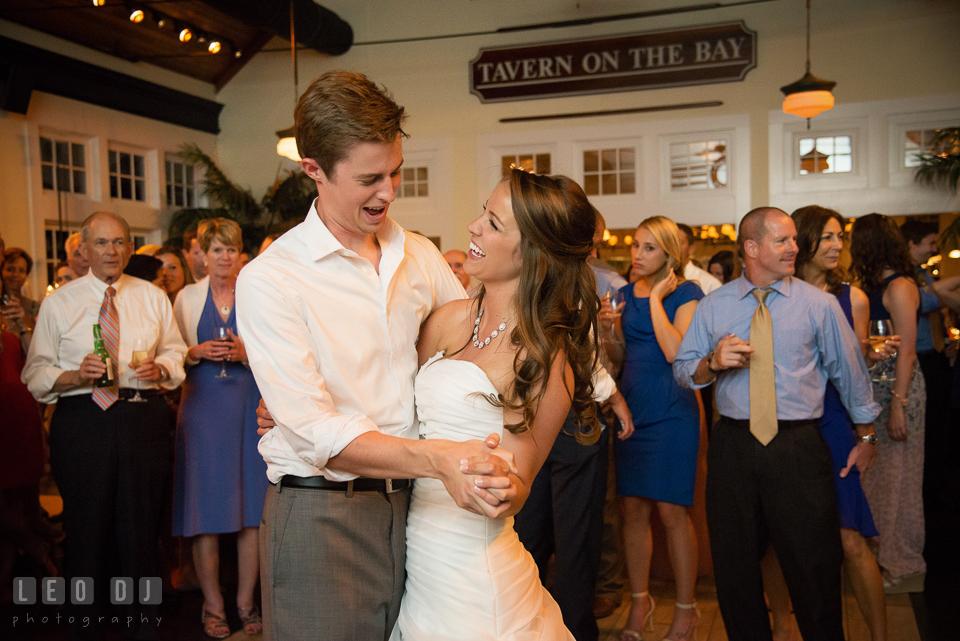 Bride and Groom laughing while dancing together. Kent Island Maryland Chesapeake Bay Beach Club wedding photo, by wedding photographers of Leo Dj Photography. http://leodjphoto.com