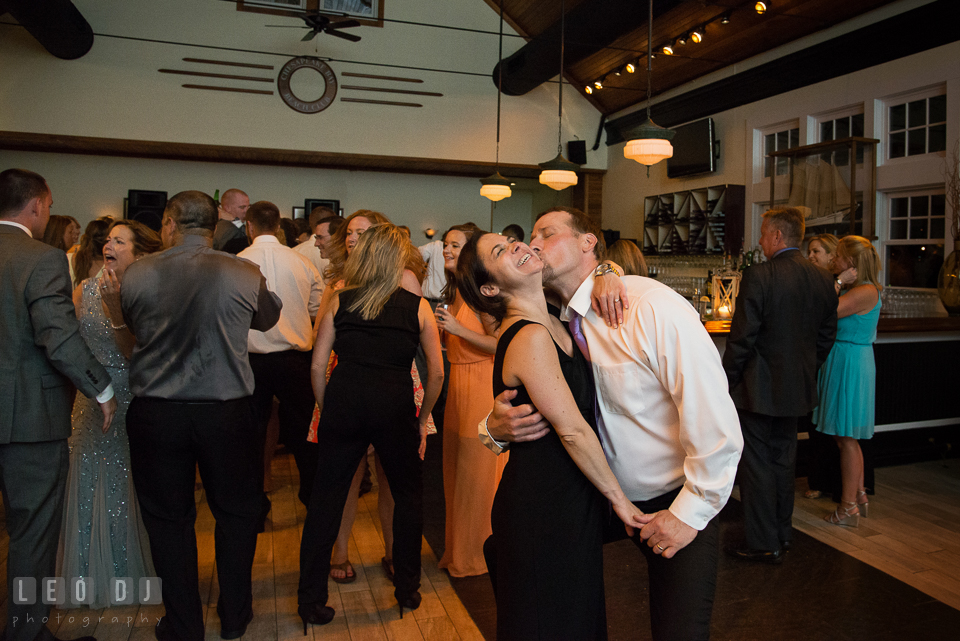 Guest couple laughing and kissed while dancing. Kent Island Maryland Chesapeake Bay Beach Club wedding photo, by wedding photographers of Leo Dj Photography. http://leodjphoto.com