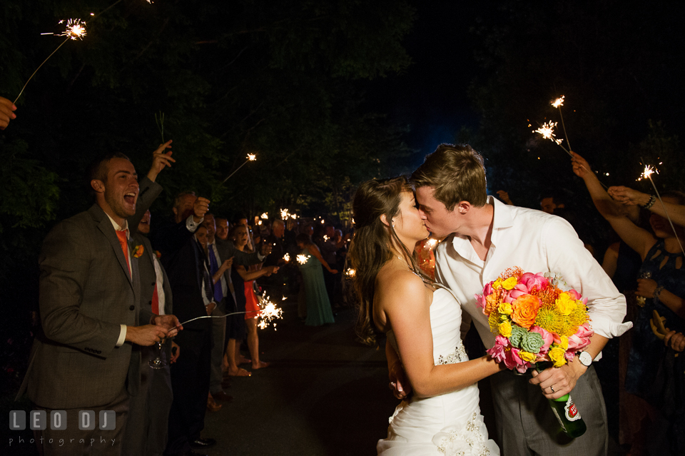 Bride and Groom kissing during their grand exit with sparklers. Kent Island Maryland Chesapeake Bay Beach Club wedding photo, by wedding photographers of Leo Dj Photography. http://leodjphoto.com