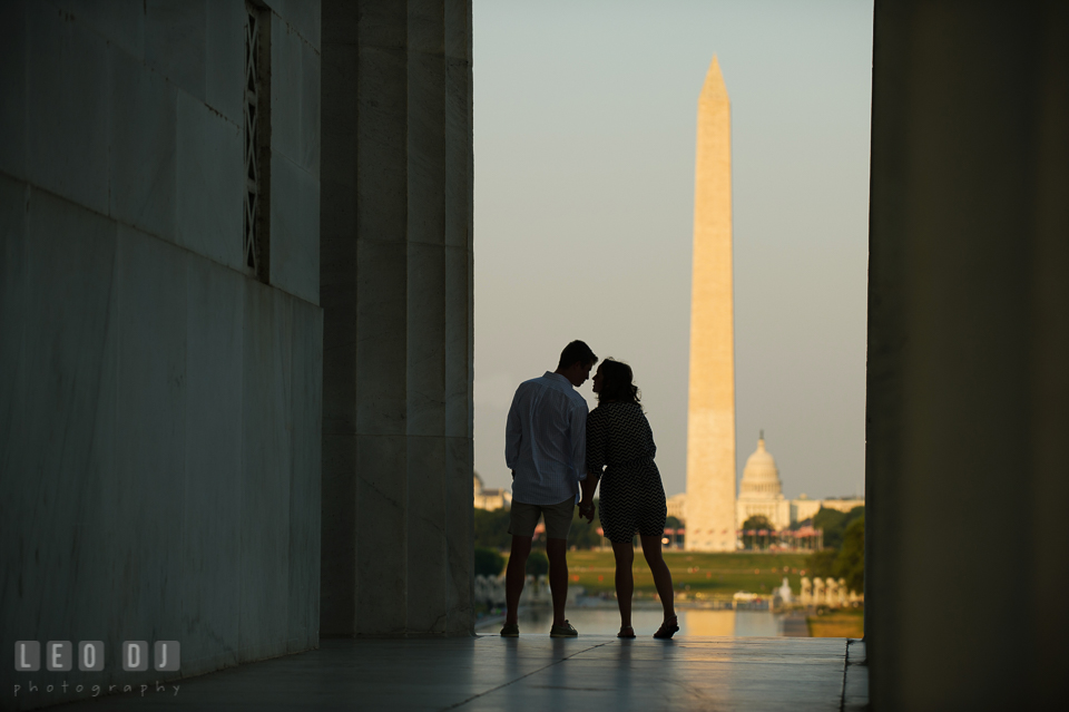 Engaged couple almost kissed with Washington monument and the Capitol in the background. Washington DC pre-wedding engagement photo session at Lincoln Memorial, by wedding photographers of Leo Dj Photography. http://leodjphoto.com