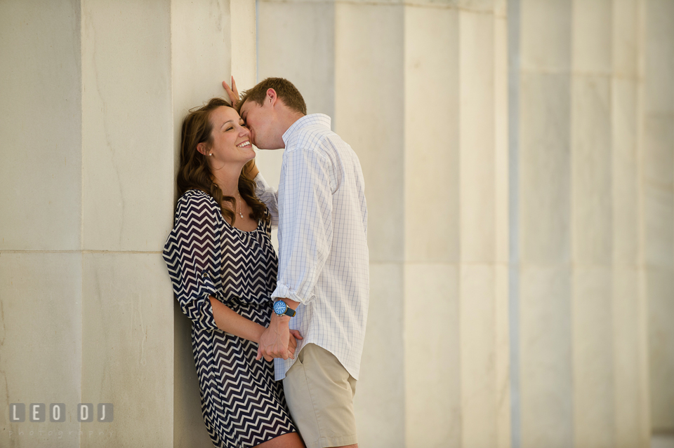 Engaged girl kissed on the cheek by her fiancé. Washington DC pre-wedding engagement photo session at Lincoln Memorial, by wedding photographers of Leo Dj Photography. http://leodjphoto.com