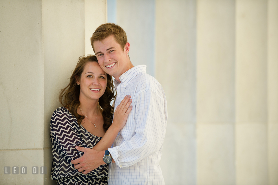 Engaged couple posing by the large marble columns. Washington DC pre-wedding engagement photo session at Lincoln Memorial, by wedding photographers of Leo Dj Photography. http://leodjphoto.com