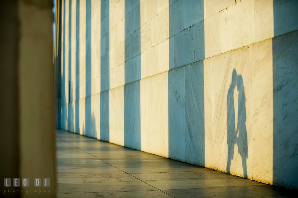 Shadow of engaged couple holding hands and almost kissing. Washington DC pre-wedding engagement photo session at Lincoln Memorial, by wedding photographers of Leo Dj Photography. http://leodjphoto.com