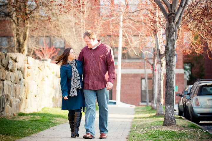 Engaged couple walking and smiling down the sidewalk. Pre-wedding Engagement Photo Session Federal Hill Baltimore and Mother's Grille restaurant bar by wedding photographer Leo Dj Photography