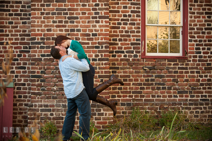 Engaged guy lift up his fiancé and kissed her. Annapolis Eastern Shore Maryland pre-wedding engagement photo session at downtown, by wedding photographers of Leo Dj Photography. http://leodjphoto.com