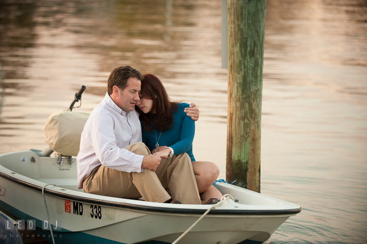 Engaged girl cuddling with her fiancé on a boat on a pier at Eastport. Annapolis Eastern Shore Maryland pre-wedding engagement photo session at downtown, by wedding photographers of Leo Dj Photography. http://leodjphoto.com