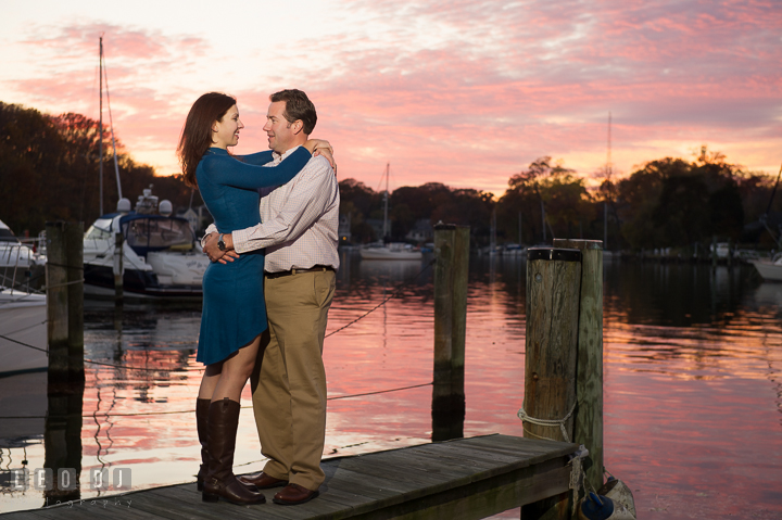 Engaged couple embracing on a boat dock at Eastport with gorgeous sunset sky. Annapolis Eastern Shore Maryland pre-wedding engagement photo session at downtown, by wedding photographers of Leo Dj Photography. http://leodjphoto.com