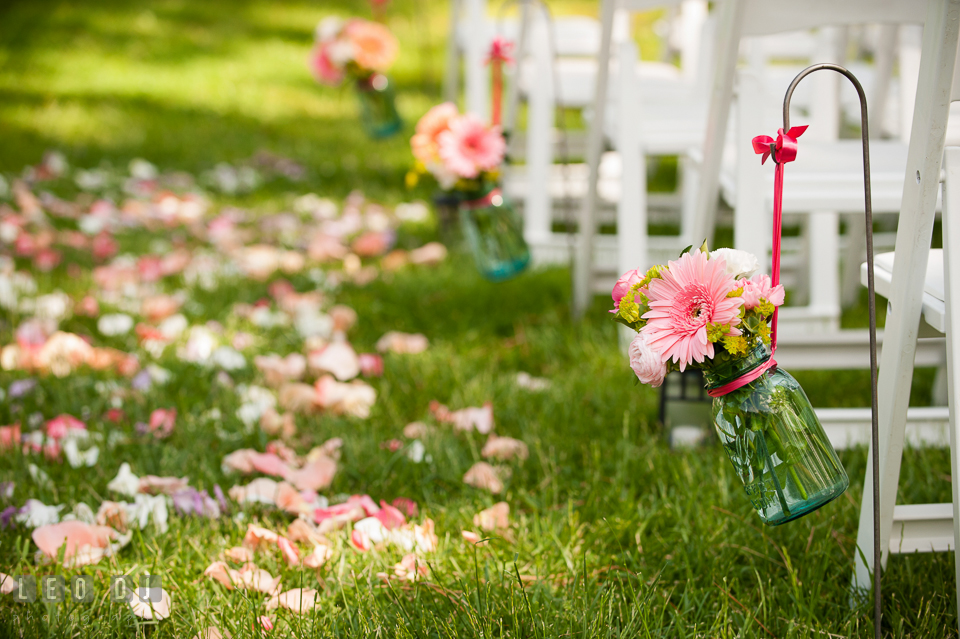 Rows of gerbera daisies for aisle decorations from florist Magnolia Floral Design. Chesapeake Bay Environmental Center, Eastern Shore Maryland, wedding reception and ceremony photo, by wedding photographers of Leo Dj Photography. http://leodjphoto.com