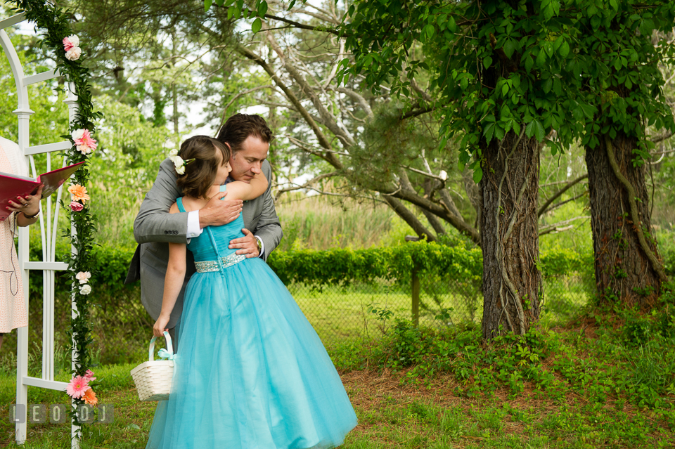 One last hug from the flower girl to the Groom before ceremony begins. Chesapeake Bay Environmental Center, Eastern Shore Maryland, wedding reception and ceremony photo, by wedding photographers of Leo Dj Photography. http://leodjphoto.com