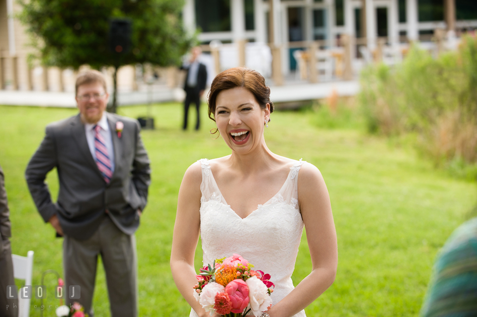 Bride happy seeing Groom for the first time during the ceremony after escorted by Father. Chesapeake Bay Environmental Center, Eastern Shore Maryland, wedding reception and ceremony photo, by wedding photographers of Leo Dj Photography. http://leodjphoto.com
