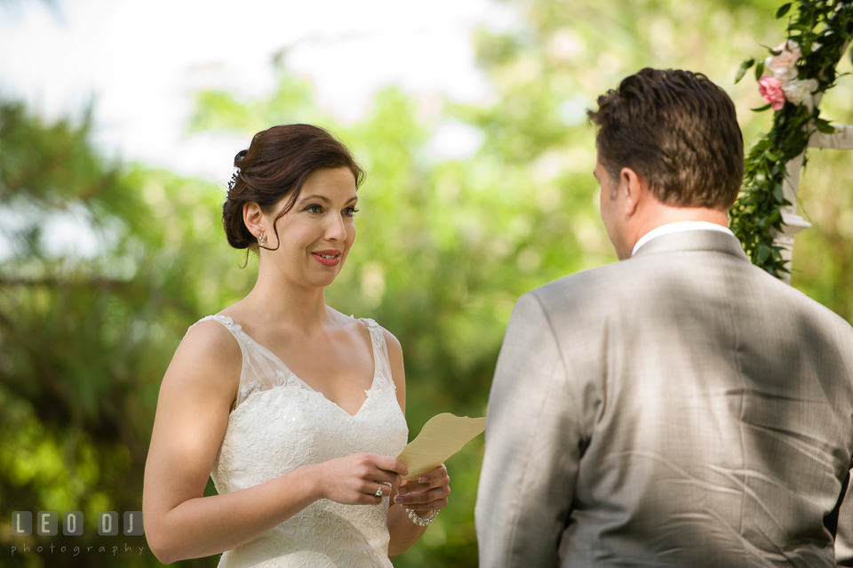 Bride reading her wedding vow. Chesapeake Bay Environmental Center, Eastern Shore Maryland, wedding reception and ceremony photo, by wedding photographers of Leo Dj Photography. http://leodjphoto.com