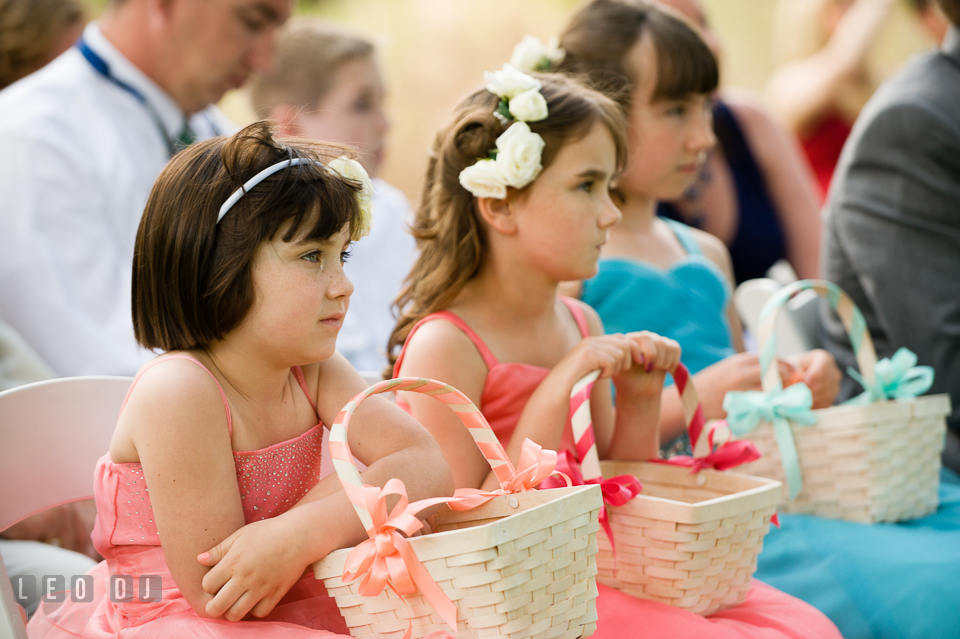 Overwhelmed by emotion, the young flower girl shed tears during the wedding ceremony. Chesapeake Bay Environmental Center, Eastern Shore Maryland, wedding reception and ceremony photo, by wedding photographers of Leo Dj Photography. http://leodjphoto.com